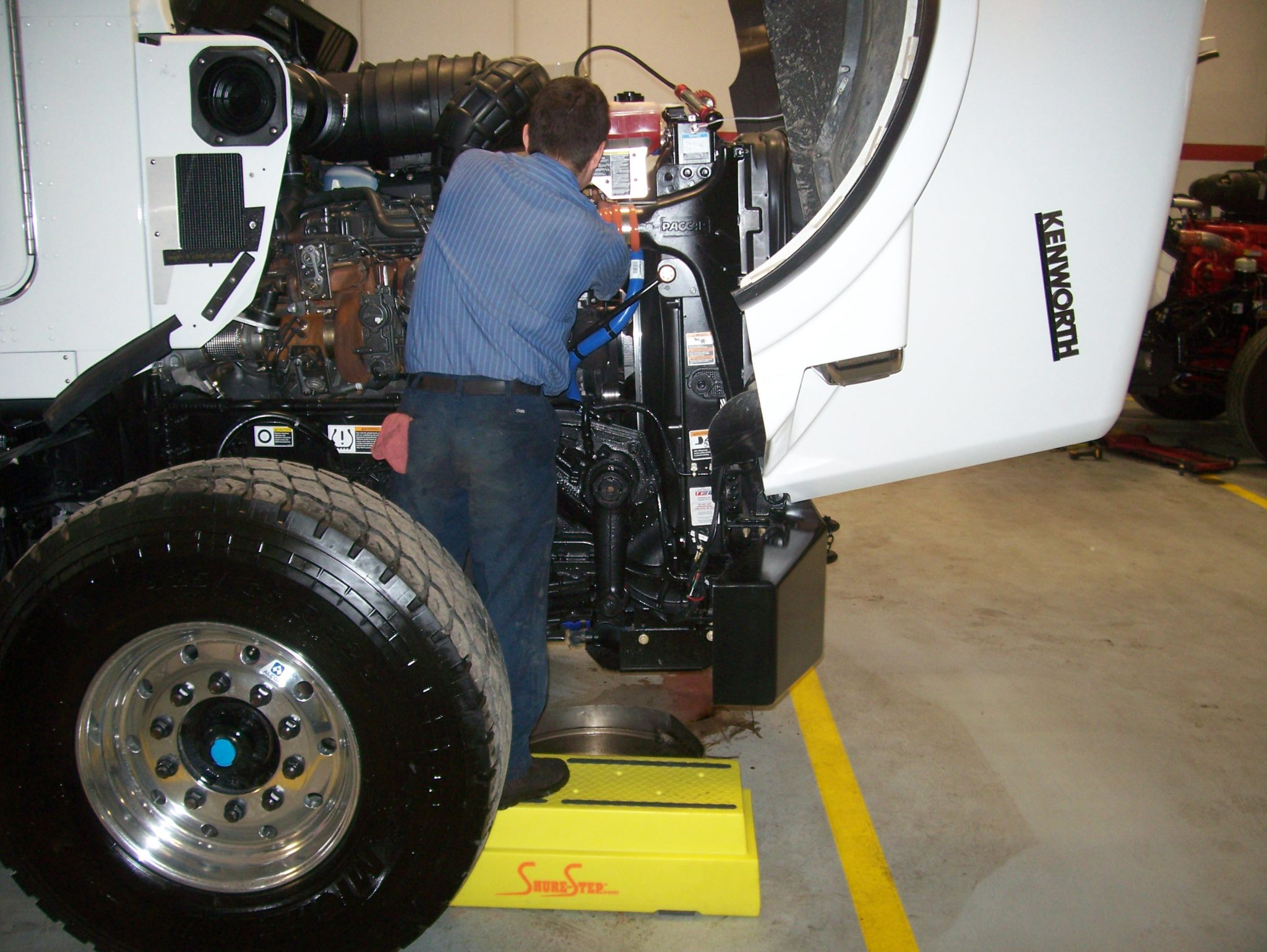 Safely Elevate Your Mechanics To Work On Large Trucks